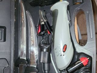 RAPAlA  Electric Knife  Has a built in cutting board on side of case