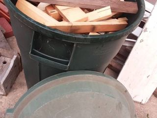 32 Gal Trashcan with Assorted Pieces of Scrap Wood