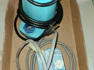 Utility Pumps  1 used and 1 in box  The pump on box is a lITTlE GIANT Water Wizard 5 AMPS