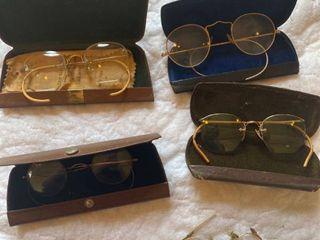 4 pairs old eyeglasses