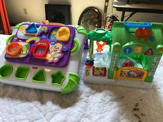 two infant learning musical toys