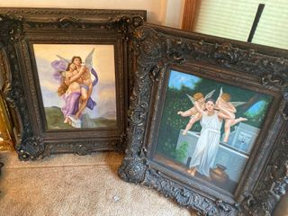 two framed angel paintings