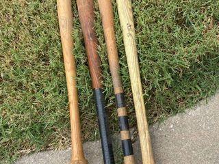 4 wooden bats