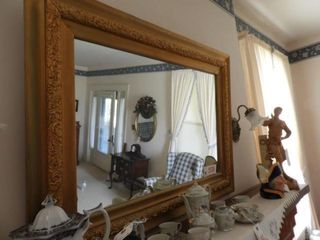Antique gold decorated framed mirror