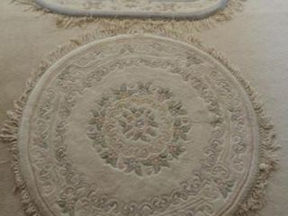 (2) Machined rugs (one 54? round, one 68? x