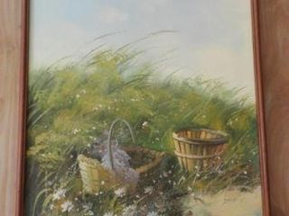 Framed oil on canvas of field and basket signed