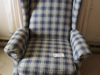 Contemporary plaid upholstered wingback recliner