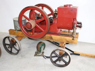 RED STATIONARY ENGINE ON 4 WHEEl CART