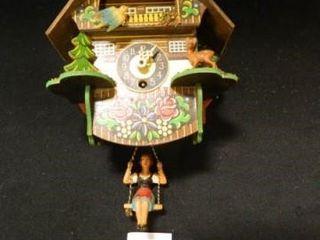 German Clock w Girl on Swing