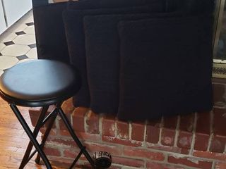 Black Folding Bar Stool  24 5 in  tall  Black Framed Mirror  21 5 x 25 5 in  5 Black Square Throw Pillows and Black Candleholder