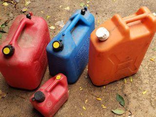 Plastic Fuel   Water Cans   2 Gas  1 Kerosene and 5 gal  water jug