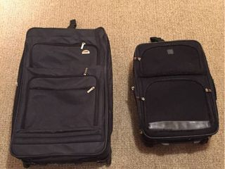 2 pieces of rolling travel luggage