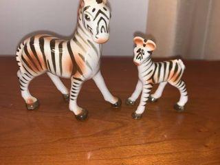 Two Porcelain Zebras location Mantel