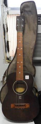 Lot #3765 -SLH four string Ukulele/guitar 30