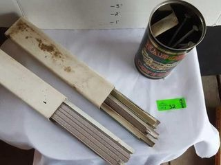 2 boxes of siding edging pieces and a tin of