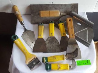 Collection of putty knifes, paint scrapper,