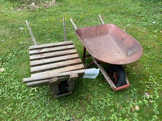 Wood plank and metal wheelbarrows