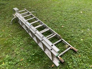 Lot of sliding ladders and Step ladder