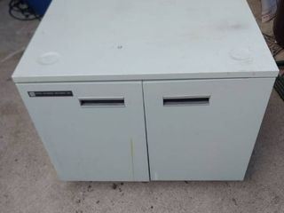 metal office cabinet with two doors 27 in wide 22in deep on rollers