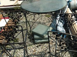 wrought iron glass top table four chairs and only three cushions