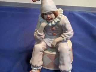 musical clown figurine plays send in the clown