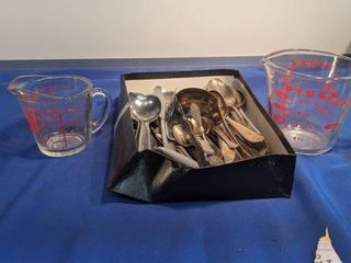 mixes flatware and measuring cups