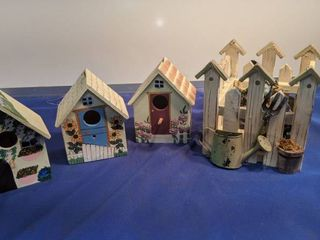 three bird houses and a garden scenery