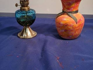 blue base hurricane lamp and vase with Clear marbles