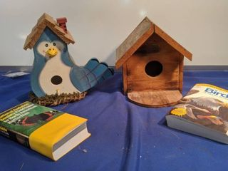 two bird houses bird book and butterfly book