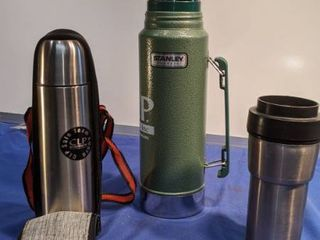 two thermos and a thermos coffee cup