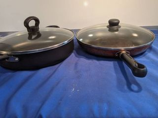 two skillets with lids