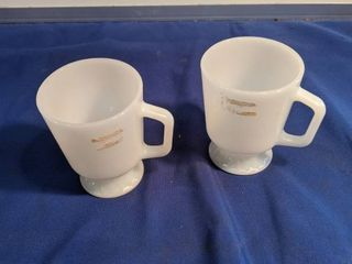 two vintage fire King coffee cups
