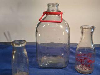 three milk jugs