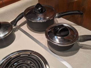 set of three pans with lids