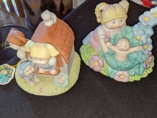 two cabbage patch figurines