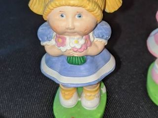 five cabbage patch figurines