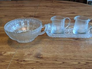 two little picher with tray and a bowl