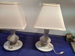 pair of white glass table lamps