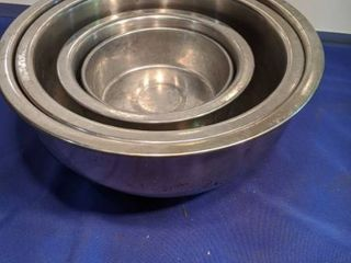set of four stainless steel bowls and one extra