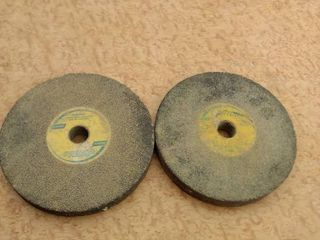 two 8 in Norton grinding wheels