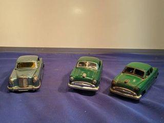 three Japan tin cars