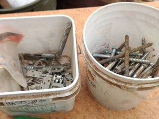 two buckets one with hasp the other one with lag bolts