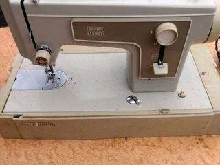 Sears Kenmore sewing machine comes on needs belt