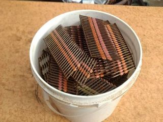 bucket full of two and a quarter inch nails for nail gun