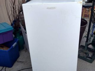 Working medium sized Frigidaire freezer 24 in wide 26 and 1 2 in deep 52 in tall