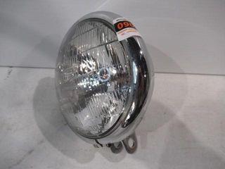 Older Chrome Headlight with Blue High Bean light