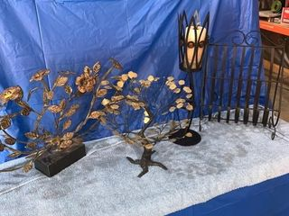 Metal ornamental trees, candle, and magazine rack