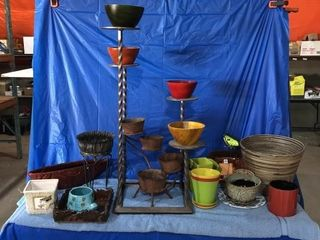 Steel plant stand and quantity of flower pots
