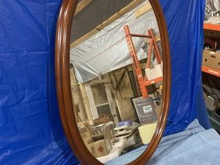 Oval mirror measures 37 x 24