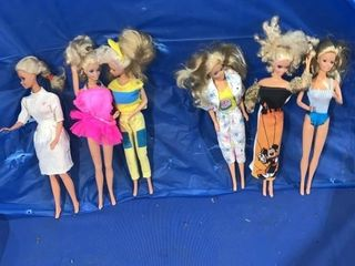 Three Mattel Barbie dolls made in Malaysia, three